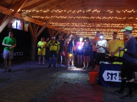 Runners with headlamps in transition area at Ragnar Trail
